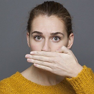woman with halitosis