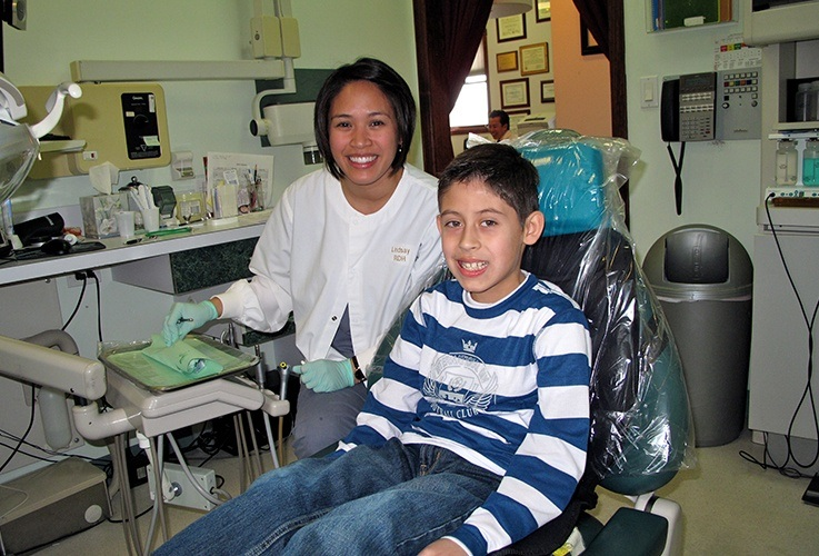 boy smiling in chair