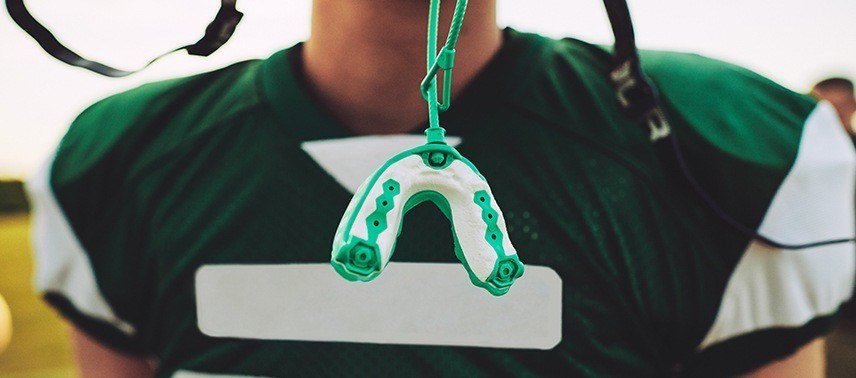 green and white mouthguard