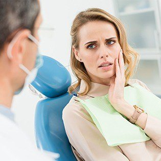 woman looking at dentist working