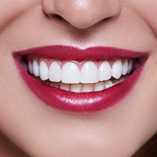woman smiling with lipstick on