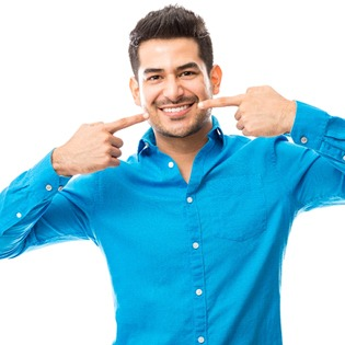 A man pointing to his smile