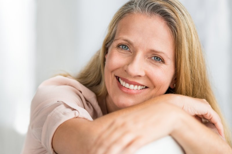 an older woman showing off her beautiful new smile thanks to dental implants in Bergenfield